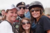 Sarah and Piper pose with veterans at Rolling Thunder rally
