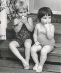 Sarah and sister Heather as toddlers - sitting on steps