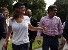 Former Governor of Alaska Sarah Palin and her husband Todd leave the paddock at the 142nd Belmont Stakes in Elmont