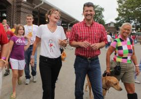 Sarah and Todd laughing as they walk together at Iowa State Fair