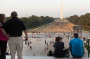 Sarah and Todd sitting and the Heaths standing on steps at National Mall