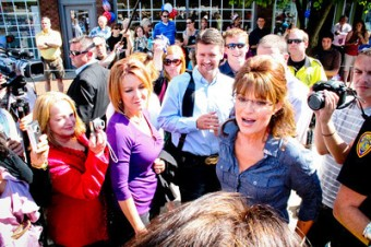 Sarah and Todd surrounded by reporters at Pella Iowa event