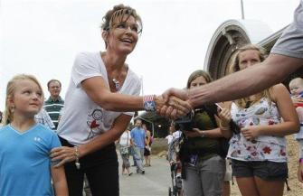 Sarah at Iowa State Fair - shaking hands with man - young girl in blue