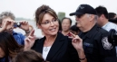 Sarah gestures as she talks with newsmen in New York on One Nation Bus Tour