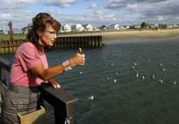 Former Alaska Governor Sarah Palin gives a thumbs up while talking to fishermen at Yankee Seafood Cooperative in Seabrook