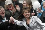 Sarah Grasps Womans Hand As She Walks to Podium in Madison WI