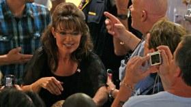 Sarah greeting crowd - black jacket