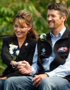 Sarah holding Todd's hand at July 26 picnic