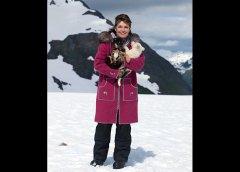 Sarah holds puppies on glacier