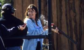 Sarah in Blue Jacket with Rifle