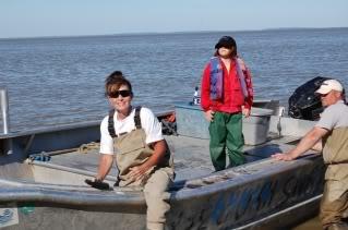Sarah in boat in waders