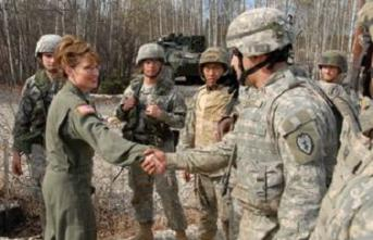 Sarah in Fatigues Shaking Hands with Military