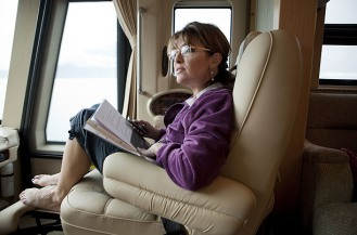 Sarah in front seat of familys RV