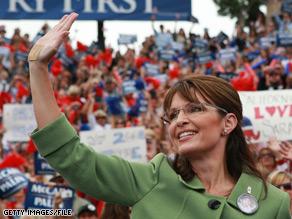 Sarah in green jacket waving