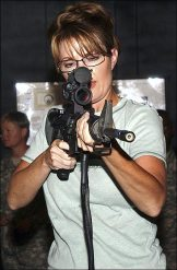 Sarah in green shirt with gun