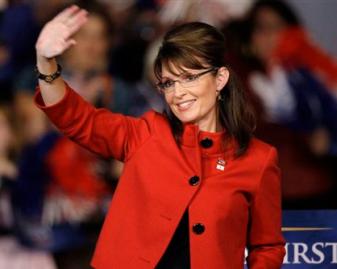 Sarah in red jacket waving at crowd