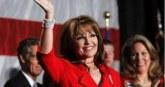 Sarah in red jacket waving