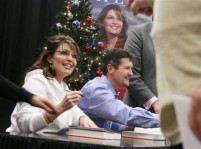 Sarah in white jacket and Todd at Fort Hood book signing