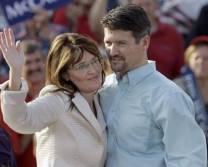 Sarah in white jacket - waving - Todd in blue shirt