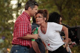 Sarah leaning toward Todd to say something at Iowa state fair