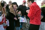 Sarah Looking at Young Girl's Palin Banner Before Book Signing in Richmond