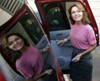 Former Alaska Governor Palin prepares to climb into her car, in Portsmouth