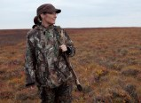 Sarah paused while hunting with rifle by side