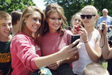 Sarah poses for cellphone photos in Boston on One Nation Bus Tour
