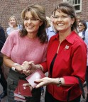 Sarah poses with celebrity impersonator in Boston - has copies of Consitution in her hands