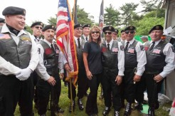 Sarah poses with unit at Rolling Thunder rally