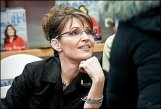 Sarah resting chin on hand at Coeur d-Alene booksigning