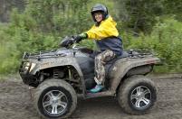 Sarah riding ATV when visiting gold mine