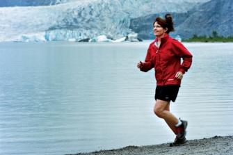 Sarah running in front of glacier
