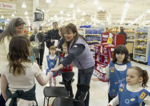 Sarah Selling Cookies with Girl Scouts