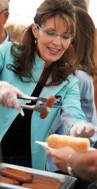 Sarah serving hotdog at Governors Picnic