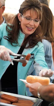 Sarah serving hotdog at Governors Picnic
