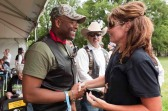 Sarah shakes hands with Allen West at Rolling Thunder