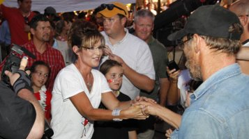 Sarah shakes hands with man at Iowa State Fair - Piper - Todd