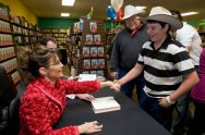 Sarah Shakes Young Man's Hand at Richland Book Signing