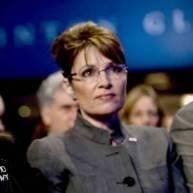 Sarah Solemn in Gray Jacket