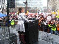 Sarah Standing Behind Podium in Madison WI