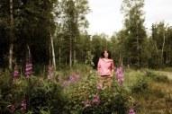 Sarah standing in field of wildflowers - Newsweek Photo Shoot