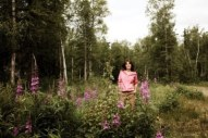Sarah standing in field of wildflowers - Newsweek Photo Shoot