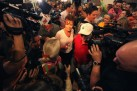 Sarah surrounded by reporters at Iowa state fair