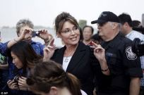 Sarah surrounded by tourist as she tours Statue of Liberty