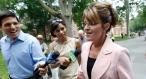 Sarah talking to reporters as she walks in Philadephia - pink jacket