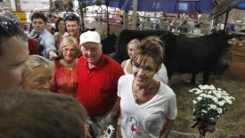 Sarah talks to visitors in Cattle Barn at Iowa State Fair - Todd