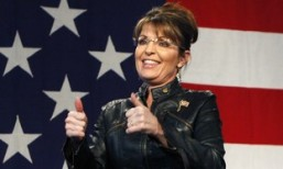 Former Alaska governor and vice presidential candidate Sarah Palin acknowledge the crowd during a campaign rally for McCain at the Pima County Fairgrounds in Tucson