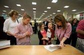 Sarah Trig and Piper Look at Coloring Book at Villages Book Signing