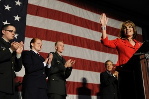 Sarah waves at crowd at Colorado State University Tribute to the Troops